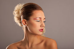 Beautiful woman with fashion hairstyle and glamour. Makeup, studio Stock Image