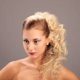 Beautiful woman with fashion hairstyle and glamour. Makeup, studio Royalty Free Stock Photo