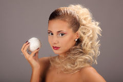 Beautiful woman with fashion hairstyle and glamour. Makeup, studio Stock Images