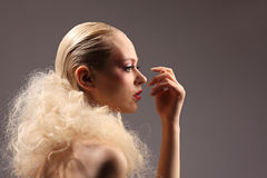 Beautiful woman with fashion hairstyle and glamour makeup. Studio Royalty Free Stock Photography