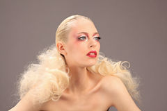 Beautiful woman with fashion hairstyle and glamour makeup. Studio Stock Image