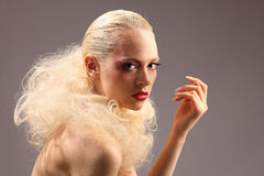 Beautiful woman with fashion hairstyle and glamour makeup. Studio Stock Photography