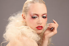 Beautiful woman with fashion hairstyle and glamour makeup. Studio Royalty Free Stock Photo