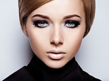 Beautiful woman with fashion makeup of eyes. Stock Photos