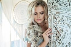 Beautiful Woman Fashion Model with Blonde Curly Hair Royalty Free Stock Photography