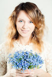 Beautiful Woman Fashion Model with Blue Flowers Stock Photos