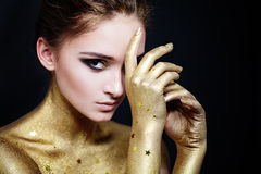 Beautiful Woman Fashion Model with Golden Skin Stock Photography
