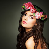 Beautiful Woman Fashion Model with Makeup and Flowers Royalty Free Stock Image