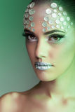 Beautiful woman fashion rhinestone make up green color stock image