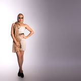 Beautiful woman. Beautiful fashion woman in sunglasses over grey background Stock Photo
