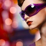 Beautiful woman in fashion violet sunglasses. Portrait of beautiful stylish woman in fashion violet sunglasses royalty free stock photo