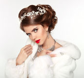 Beautiful woman in fashion white Mink Fur Coat. Luxury Winter Gi Royalty Free Stock Image