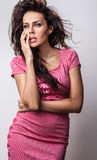 Beautiful woman on fashionable dress pose in studio. Stock Photography