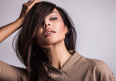 Beautiful woman on fashionable dress pose in studio. Stock Image