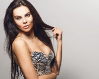 Beautiful woman on fashionable dress pose in studio. Royalty Free Stock Photos