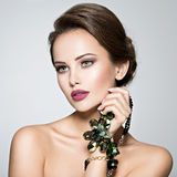 Beautiful woman with fashionable green jewelry Royalty Free Stock Photography