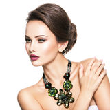 Beautiful woman with fashionable green jewelry Royalty Free Stock Image