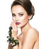 Beautiful woman with fashionable green jewelry Stock Photos