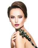 Beautiful woman with fashionable green jewelry Royalty Free Stock Images