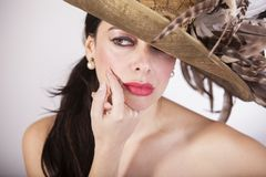 Beautiful woman with feather hat, and red lips. Retro fashion stock photo