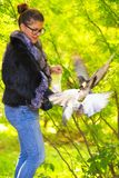 Beautiful woman feeding pigeons in the park Stock Photography