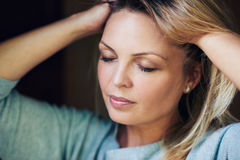 Beautiful woman feeling her soft blond hair Stock Photography