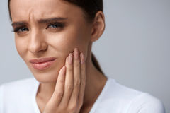 Beautiful Woman Feeling Tooth Pain, Painful Toothache. Health Royalty Free Stock Photography