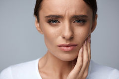 Beautiful Woman Feeling Tooth Pain, Painful Toothache. Health. Teeth Problem. Woman Feeling Tooth Pain. Closeup Of Beautiful Sad Girl Suffering From Strong Tooth royalty free stock image