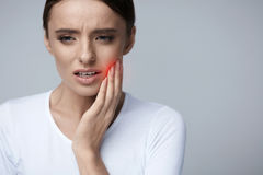 Beautiful Woman Feeling Tooth Pain, Painful Toothache. Health stock image