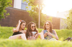3 Beautiful woman feels good in the grass Royalty Free Stock Photo