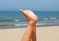 Beautiful woman feet on the beach Stock Photos