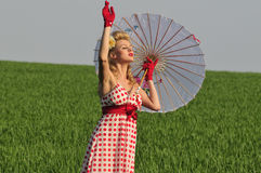 Beautiful woman in the field Royalty Free Stock Images