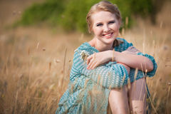 Beautiful woman in field Stock Photos
