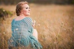 Beautiful woman in field Stock Image