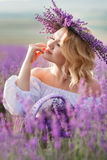 Beautiful woman in a field of blossoming lavender Stock Photos