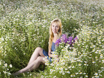 Beautiful woman in the field of camomiles Stock Images
