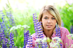 Beautiful woman in the field with lupin Stock Photo
