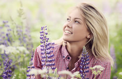 The beautiful woman in the field with lupin Royalty Free Stock Photo