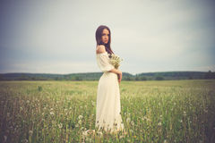 Beautiful woman in field Royalty Free Stock Images