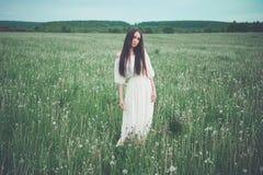 Beautiful woman in field Stock Photo