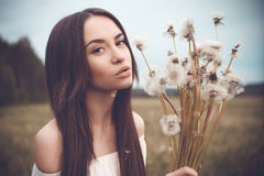 Beautiful woman in field Stock Images