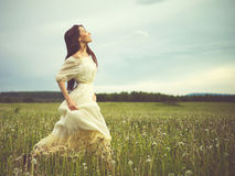 Beautiful woman in field Royalty Free Stock Image