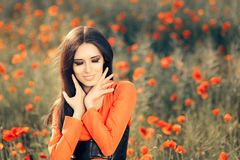 Beautiful Woman in a Field of Poppies Royalty Free Stock Images