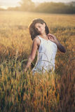 Beautiful woman in a field Royalty Free Stock Photography