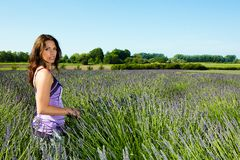 Beautiful Woman in a field of purple lavender Royalty Free Stock Photography