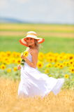 Beautiful woman on field in summer Stock Photography