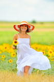 Beautiful woman on field in summer Royalty Free Stock Photo