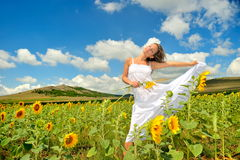 Beautiful woman on field in summer Royalty Free Stock Image
