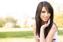 Beautiful woman on field in summer Stock Image