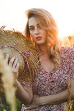 Beautiful woman in field at summer sunset Stock Image